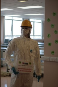 Dummy wearing face mask and hard hat.