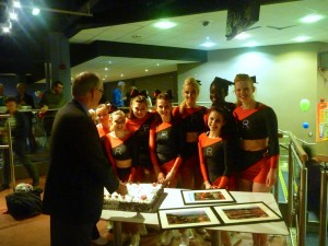 Vice Chancellor cutting a cake and my cheerleading team