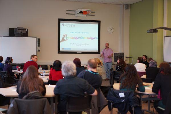 John Fairhall presenting.